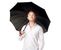 Young man under an umbrella isolated on white background Royalty Free Stock Images