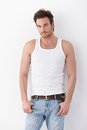 Young man in undershirt and jeans Royalty Free Stock Photo