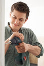 Young Man Using Electric Drill In House Renovation Project Royalty Free Stock Photo
