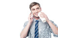 Young man using his mobile while drinking coffee handsome and cell phone Royalty Free Stock Photos