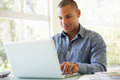 Young Man Using Laptop At Home Royalty Free Stock Photo