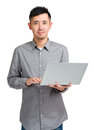 Young man using laptop isolated on white Stock Images