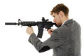 Young man using machine gun Royalty Free Stock Photo