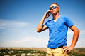 Young man using mobile smart phone summer outdoor Royalty Free Stock Images