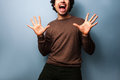 Young man is very excited and i raising his arms in joy Stock Images