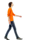 Young man walking looking up side view one caucasian in studio white background Royalty Free Stock Photography