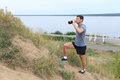 A young man walking on the trail. travel sport lifestyle concept. Young athlete drinking fresh water Royalty Free Stock Photo