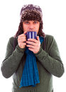 Young man warming up with hot tea Stock Photo