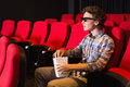 Young man watching a d film at the cinema Royalty Free Stock Images