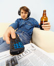 Young man watching TV Stock Image