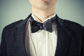 Young man wearing a bow tie and tuxedo closeup on dinner jacket Royalty Free Stock Images