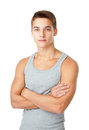Young man wearing a gray t shirt standing with hands folded agai portrait of against isolated on white background Royalty Free Stock Photos
