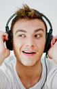Young man wearing headphones Royalty Free Stock Images