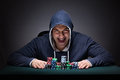 The young man wearing a hoodie with cards and chips gambling Royalty Free Stock Photo
