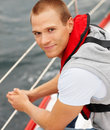 Young man wearing a life jacket in a sail boat Royalty Free Stock Photography