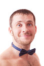 Young man is wearing nothing but a bow tie smiling Stock Photo