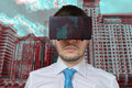 Young man is wearing virtual reality glasses. 3D simulation of city Royalty Free Stock Photo