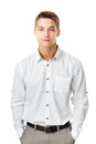 Young man wearing a white shirt portrait of against isolated on background Royalty Free Stock Image