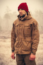 Young man wearing winter hat clothing outdoor with foggy nature on background travel lifestyle and melancholy emotions concept Stock Photography