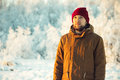 Young man wearing winter hat fashion clothing outdoor snow nature on background travel lifestyle and melancholy emotions Royalty Free Stock Photos