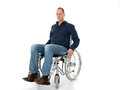 Young man in wheelchair front of white background Royalty Free Stock Photos