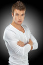 Young man in white shirt portrait of on black background Stock Photos