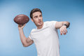Young man in white t-shirt playing football with rugby ball Royalty Free Stock Photo