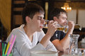Young man who has had too much to drink men sitting sipping his beer at counter pub with dull eyed expression stares alcohol glass Royalty Free Stock Images