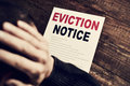 Young man who has received an eviction notice Royalty Free Stock Photo