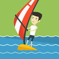 Young man windsurfing in the sea. Royalty Free Stock Photo