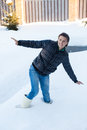 Young man in winter boots fell into a deep white snow Royalty Free Stock Images
