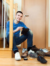 Young man woman cleaning shoes Royalty Free Stock Photo