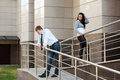 Young man and woman in conflict couple at the office building Stock Photo