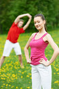 Young man and woman doing stretching exercises Royalty Free Stock Image