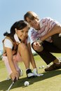 Young Man And Woman On Golf Course Royalty Free Stock Photo