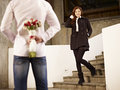 Young man and woman in love asian men waiting by the steps with flowers behind back for his girlfriend Stock Photography