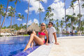 Young man and woman - relax near the swimming pool Royalty Free Stock Photo