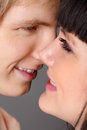 Young man and woman smile close up Royalty Free Stock Photo