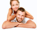 Young man and woman together over white background lovely couple lying on the floor isolated on Stock Photo