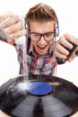 Young man working as dj with ear-phones and glasses. Royalty Free Stock Photo