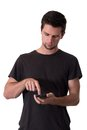 Young Man Working On His Smartphone Royalty Free Stock Photography