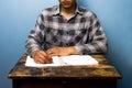 Young man writing at desk Royalty Free Stock Photo