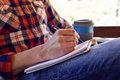 Young man writing in a notebook Royalty Free Stock Photo