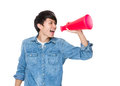 Young man yell with loudspeaker isolated on white background Royalty Free Stock Image