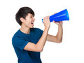 Young man yell with loudspeaker Royalty Free Stock Photo