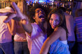 Young man and young woman dancing in a nightclub Royalty Free Stock Photo