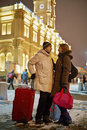 Young man and young woman stand on railway platform men women in winter evening looking at each other Royalty Free Stock Photos