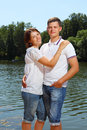 Young married couple against a summer landscape Stock Images