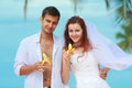 Young married couple on a beach in a tropical destination Stock Photo