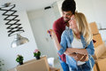 Young married couple with boxes and holding flat keys Royalty Free Stock Photo